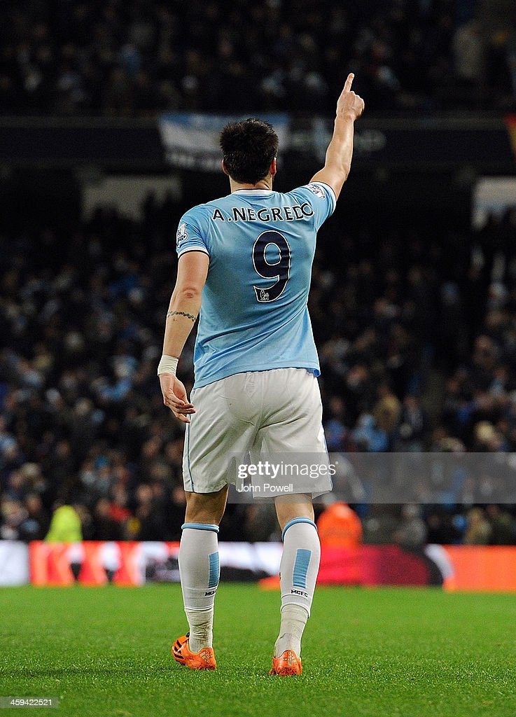 <a gi-track='captionPersonalityLinkClicked' href=/galleries/search?phrase=Alvaro+Negredo&family=editorial&specificpeople=4085785 ng-click='$event.stopPropagation()'>Alvaro Negredo</a> of Manchester City celebrates after scoing the second during the Barclays Premier League match between Manchester United and Liverpool at Etihad Stadium on December 26, 2013 in Manchester, England.