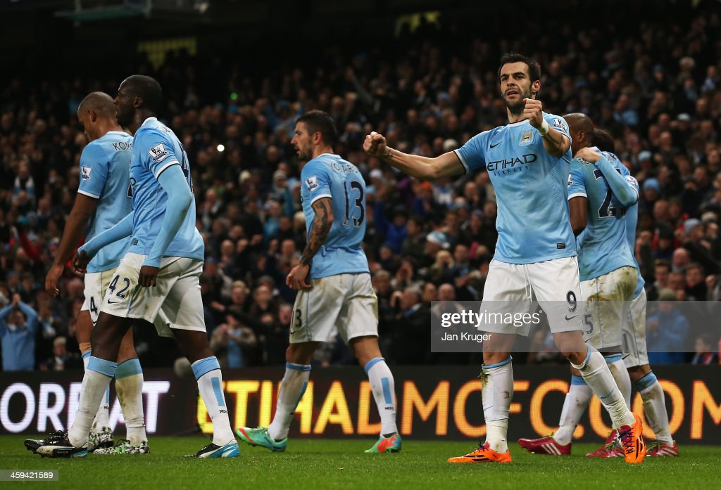 <a gi-track='captionPersonalityLinkClicked' href=/galleries/search?phrase=Alvaro+Negredo&family=editorial&specificpeople=4085785 ng-click='$event.stopPropagation()'>Alvaro Negredo</a> of Manchester City celebrates his goal during the Barclays Premier League match between Manchester City and Liverpool at Etihad Stadium on December 26, 2013 in Manchester, England.