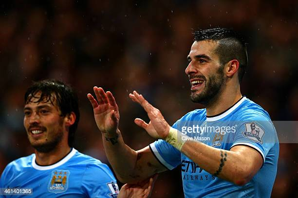 Alvaro Negredo of Manchester City celebrates scoring his second goal with David Silva of Manchester City during the Capital One Cup SemiFinal first...