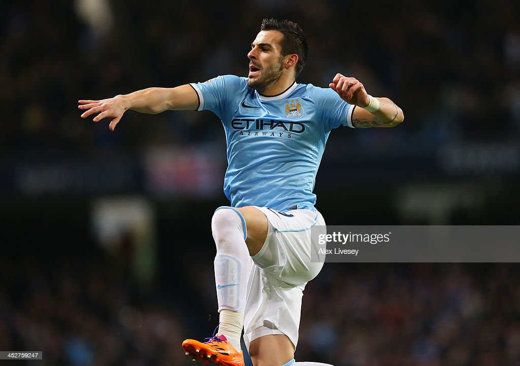 <a gi-track='captionPersonalityLinkClicked' href=/galleries/search?phrase=Alvaro+Negredo&family=editorial&specificpeople=4085785 ng-click='$event.stopPropagation()'>Alvaro Negredo</a> of Manchester City celebrates scoring the opening goal during the Barclays Premier League match between Manchester City and Swansea City at Etihad Stadium on December 1, 2013 in Manchester, England.