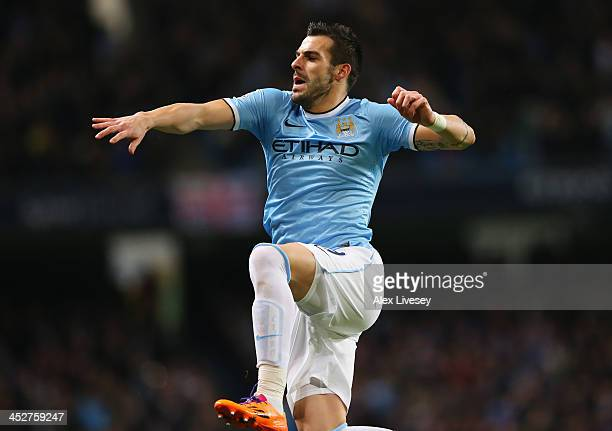 Alvaro Negredo of Manchester City celebrates scoring the opening goal during the Barclays Premier League match between Manchester City and Swansea...