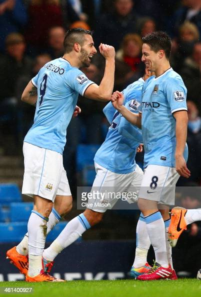 Alvaro Negredo of Manchester City celebrates scoring the opening goal with Samir Nasri of Manchester City during the Capital One Cup SemiFinal first...