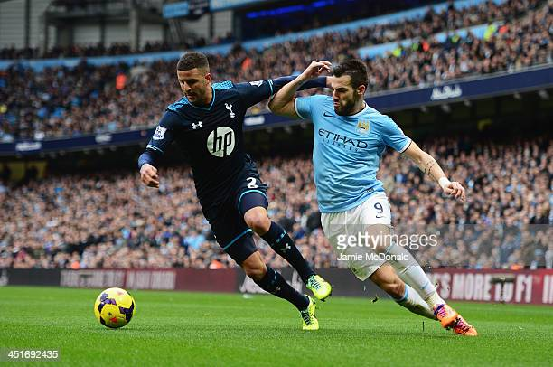 Alvaro Negredo of Manchester City challenges Kyle Walker of Tottenham Hotspur during the Barclays Premier League match between Manchester City and...