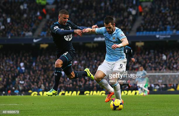 Alvaro Negredo of Manchester City holds off a challenge by Kyle Walker of Tottenham Hotspur during the Barclays Premier League match between...