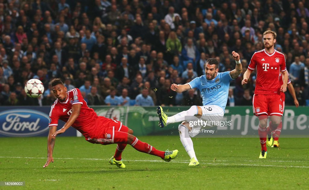 <a gi-track='captionPersonalityLinkClicked' href=/galleries/search?phrase=Alvaro+Negredo&family=editorial&specificpeople=4085785 ng-click='$event.stopPropagation()'>Alvaro Negredo</a> of Manchester City scores his team's first goal during the UEFA Champions League Group D match between Manchester City and FC Bayern Muenchen at Etihad Stadium on October 2, 2013 in Manchester, England.