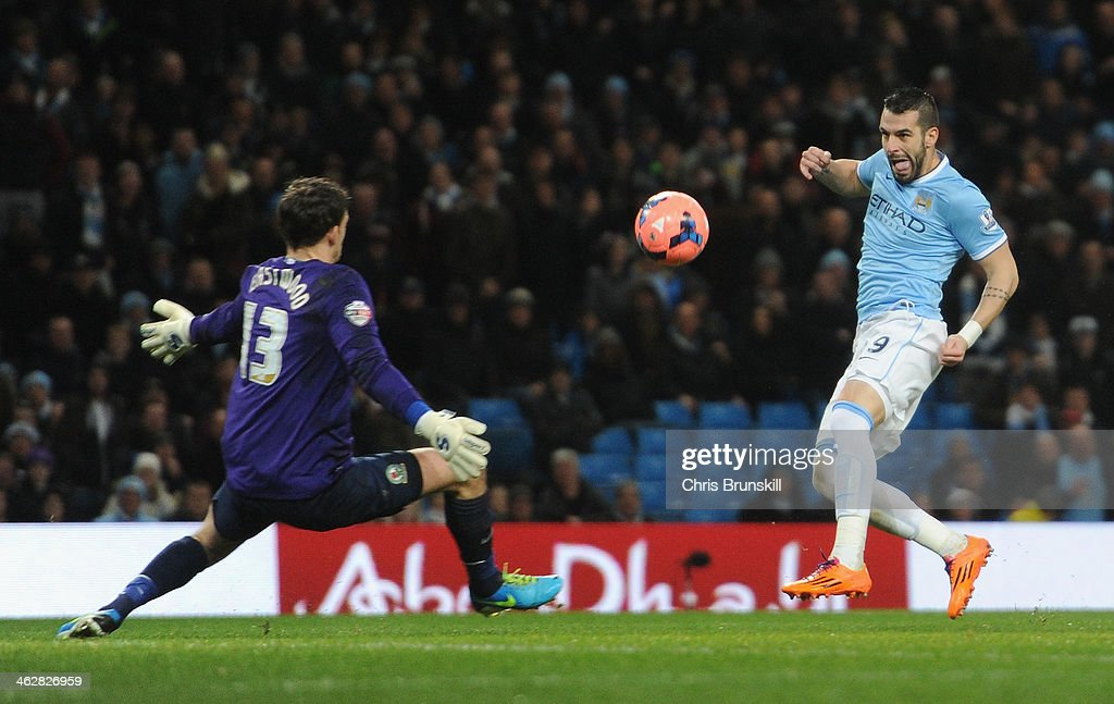 <a gi-track='captionPersonalityLinkClicked' href=/galleries/search?phrase=Alvaro+Negredo&family=editorial&specificpeople=4085785 ng-click='$event.stopPropagation()'>Alvaro Negredo</a> of Manchester City scores the second goal past Simon Eastwood of Blackburn Rovers during the Budweiser FA Cup Third Round Replay match between Manchester City and Blackburn Rovers at the Etihad Stadium on January 15, 2014 in Manchester, England.