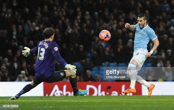 Alvaro Negredo of Manchester City scores the second goal past Simon Eastwood of Blackburn Rovers during the Budweiser FA Cup Third Round Replay match...