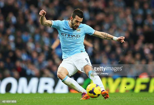 Alvaro Negredo of Manchester City shoots to score his team's fifth goal during the Barclays Premier League match between Manchester City and...