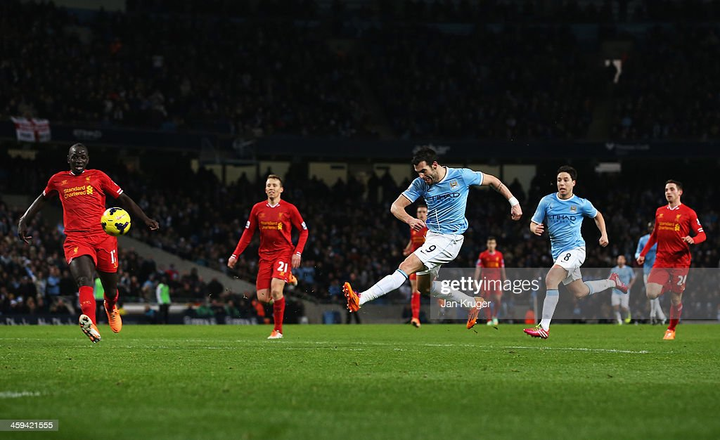 <a gi-track='captionPersonalityLinkClicked' href=/galleries/search?phrase=Alvaro+Negredo&family=editorial&specificpeople=4085785 ng-click='$event.stopPropagation()'>Alvaro Negredo</a> of Manchester City shoots to score his team's second goal during the Barclays Premier League match between Manchester City and Liverpool at Etihad Stadium on December 26, 2013 in Manchester, England.