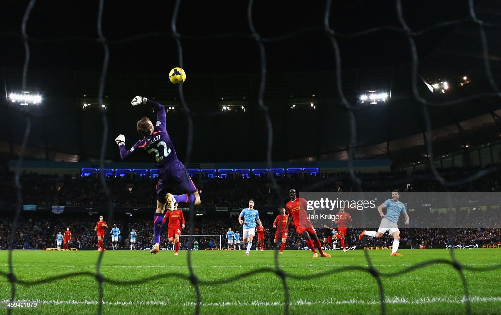 <a gi-track='captionPersonalityLinkClicked' href=/galleries/search?phrase=Alvaro+Negredo&family=editorial&specificpeople=4085785 ng-click='$event.stopPropagation()'>Alvaro Negredo</a> of Manchester City shoots to score past <a gi-track='captionPersonalityLinkClicked' href=/galleries/search?phrase=Simon+Mignolet&family=editorial&specificpeople=7124442 ng-click='$event.stopPropagation()'>Simon Mignolet</a> of Liverpool during the Barclays Premier League match between Manchester City and Liverpool at Etihad Stadium on December 26, 2013 in Manchester, England.