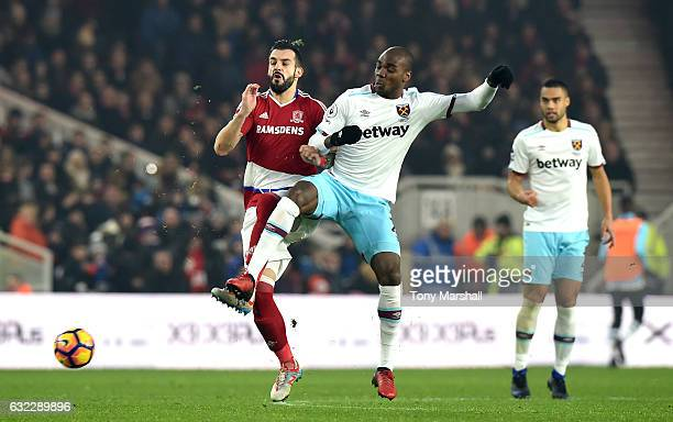 Alvaro Negredo of Middlesbrough and Angelo Ogbonna of West Ham United battle for possession during the Premier League match between Middlesbrough and...