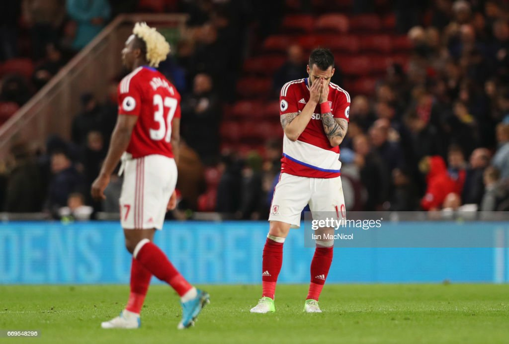 Alvaro Negredo of Middlesbrough (R) and team mate Adama Traore look dejected in defeat after during the Premier League match between Middlesbrough and Arsenal at Riverside Stadium on April 17, 2017 in Middlesbrough, England.
