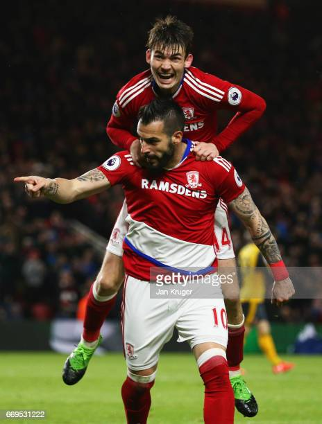 Alvaro Negredo of Middlesbrough celebrates as he scores their first goal with Marten de Roon during the Premier League match between Middlesbrough...