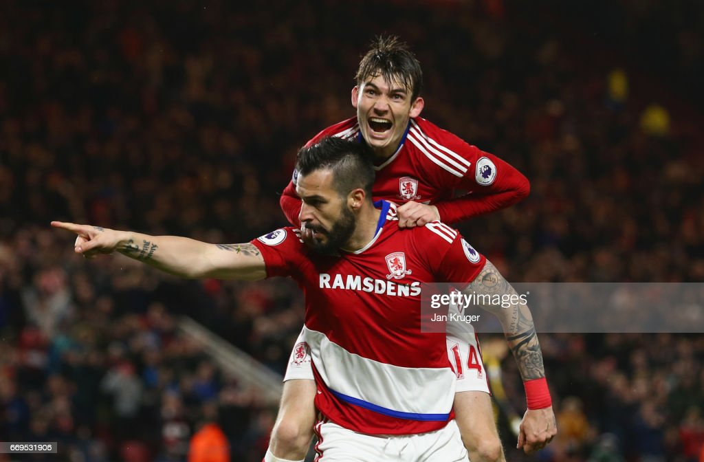 Alvaro Negredo of Middlesbrough (front) celebrates as he scores their first goal with Marten de Roon during the Premier League match between Middlesbrough and Arsenal at Riverside Stadium on April 17, 2017 in Middlesbrough, England.