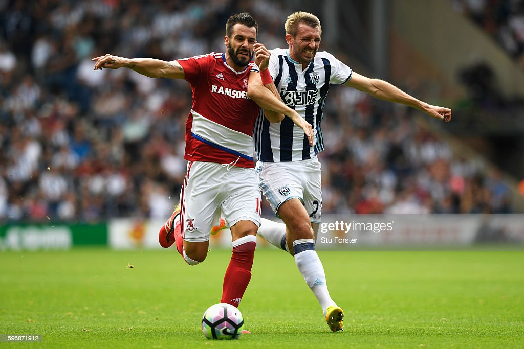 Alvaro Negredo of Middlesbrough challenges for the ball with Gareth McAuley of West Bromwich Albion during the Premier League match between West Bromwich Albion and Middlesbrough at The Hawthorns on August 28, 2016 in West Bromwich, England.