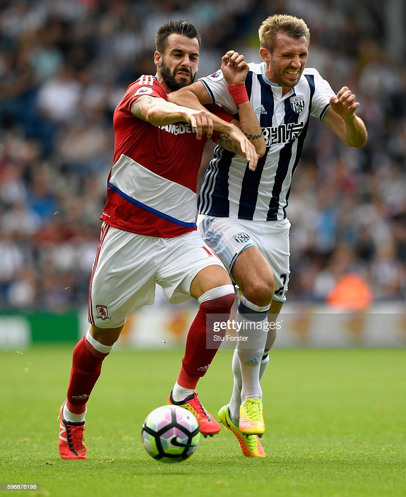 Alvaro Negredo of Middlesbrough (l) challenges for the ball with Gareth McAuley of West Bromwich Albion during the Premier League match between West Bromwich Albion and Middlesbrough at The Hawthorns on August 28, 2016 in West Bromwich, England.