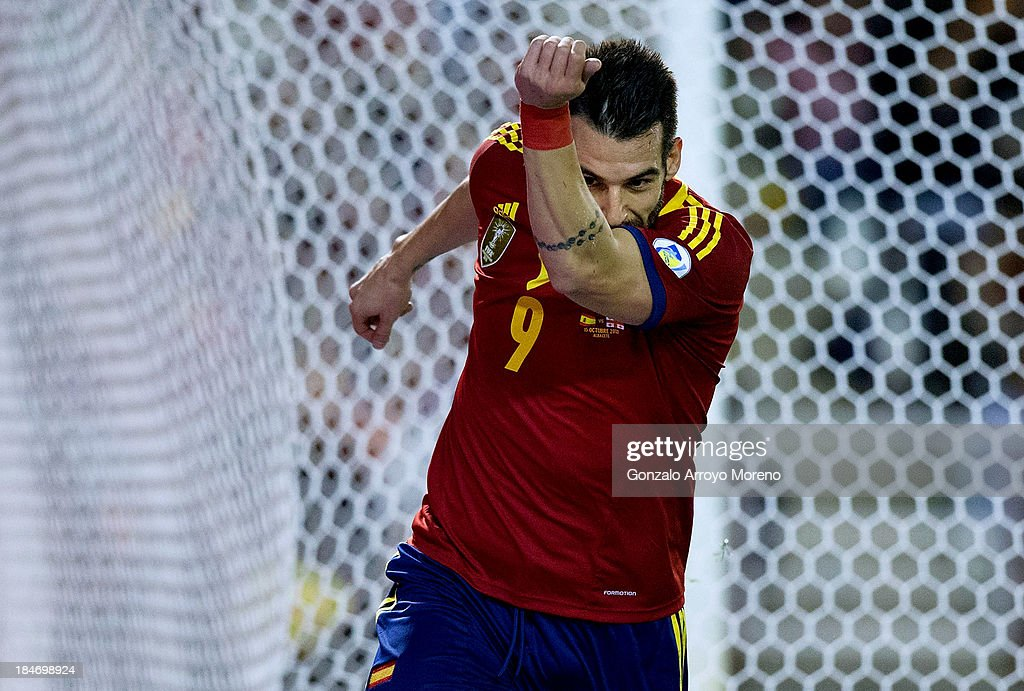 <a gi-track='captionPersonalityLinkClicked' href=/galleries/search?phrase=Alvaro+Negredo&family=editorial&specificpeople=4085785 ng-click='$event.stopPropagation()'>Alvaro Negredo</a> of Spain celebrates scoring the opening goal during the FIFA 2014 World Cup Qualifier match between Spain and Georgia at Carlos Belmonte stadium on October 15, 2013 in Albacete, Spain.