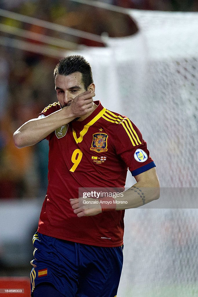 <a gi-track='captionPersonalityLinkClicked' href=/galleries/search?phrase=Alvaro+Negredo&family=editorial&specificpeople=4085785 ng-click='$event.stopPropagation()'>Alvaro Negredo</a> of Spain celebrates scoring their opening goal during the FIFA 2014 World Cup Qualifier match between Spain and Georgia at Carlos Belmonte stadium on October 15, 2013 in Albacete, Spain.