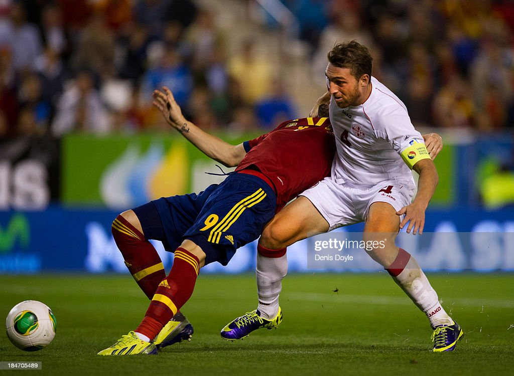 <a gi-track='captionPersonalityLinkClicked' href=/galleries/search?phrase=Alvaro+Negredo&family=editorial&specificpeople=4085785 ng-click='$event.stopPropagation()'>Alvaro Negredo</a> (L) of Spain is challenged by Guram Kashia (R) of Georgia during the FIFA 2014 World Cup Qualifier between Spain and Georgia on October 15, 2013 in Albacete, Spain.