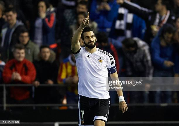 Alvaro Negredo of Valencia celebrates scoring his team's fourth goal during the UEFA Europa League round of 32 first leg match between Valencia CF...