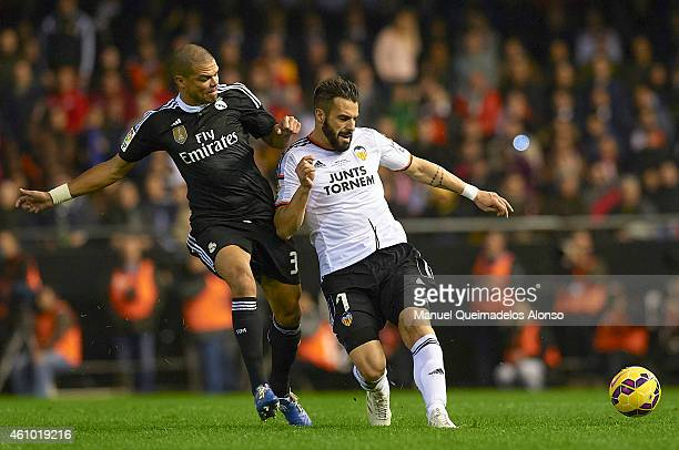 Alvaro Negredo of Valencia competes for the ball with Pepe of Real Madrid during the La Liga match between Valencia CF and Real Madrid CF at Estadi...