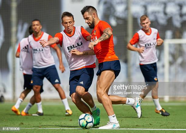 Alvaro Negredo of Valencia dispute the ball with Nemanja Maksimovic of Valencia during the preseason training session at Paterna Training Centre on...