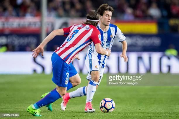 Alvaro Odriozola Arzallus of Real Sociedad battles for the ball with Filipe Luis of Atletico de Madrid during their La Liga match between Atletico de...