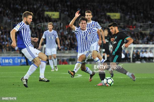 Alvaro Odriozola of Real Sociedad duels for the ball with Asensio and Casemiro during the Spanish league football match between Real Sociedad and...