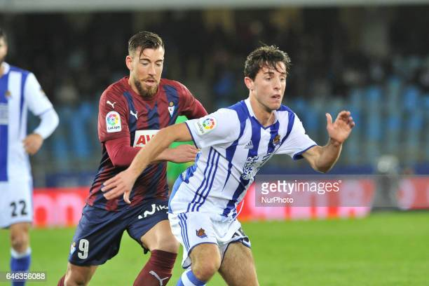 Alvaro Odriozola of Real Sociedad duels for the ball with Sergi Enrich of Eibar during the Spanish league football match between Real Sociedad and...
