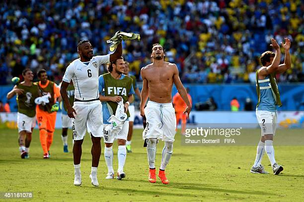 Alvaro Pereira Diego Forlan Martin Caceres and Diego Lugano of Uruguay celebrate the 10 win after the 2014 FIFA World Cup Brazil Group D match...
