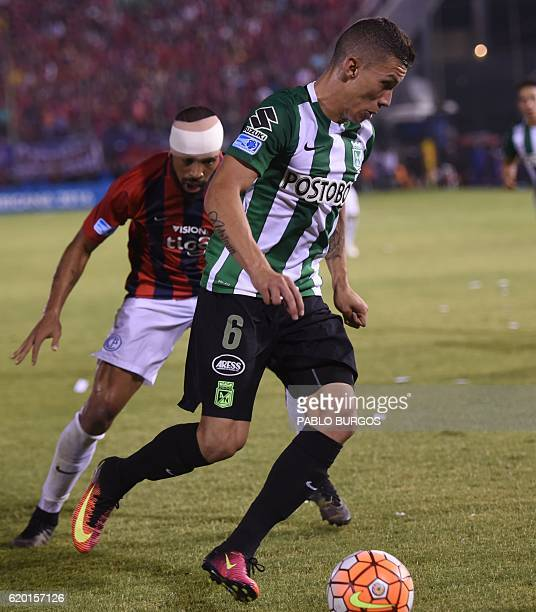 Alvaro Pereira of Paraguay's Cerro Porteno and Mateus Uribe of Colombia's Atletico Nacional vie for the ball during their Copa Sudamericana semifinal...