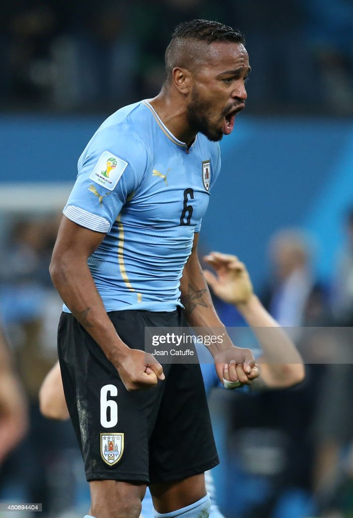 <a gi-track='captionPersonalityLinkClicked' href=/galleries/search?phrase=Alvaro+Pereira&family=editorial&specificpeople=2577731 ng-click='$event.stopPropagation()'>Alvaro Pereira</a> of Uruguay celebrates the victory at the end of the 2014 FIFA World Cup Brazil Group D match between Uruguay and England at Arena de Sao Paulo on June 19, 2014 in Sao Paulo, Brazil.