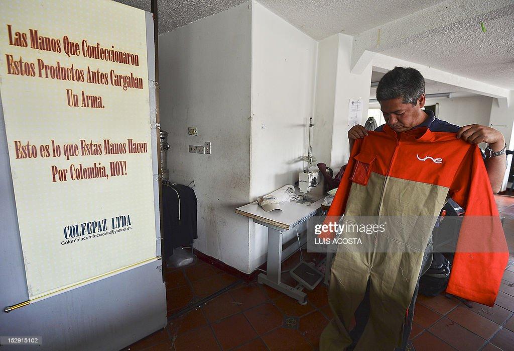 Alvaro Perez former tailor at the Fuerzas Armadas Revolucionarias de Colombia leftist guerrillas is busy at his workshop in Bogota on September 24...