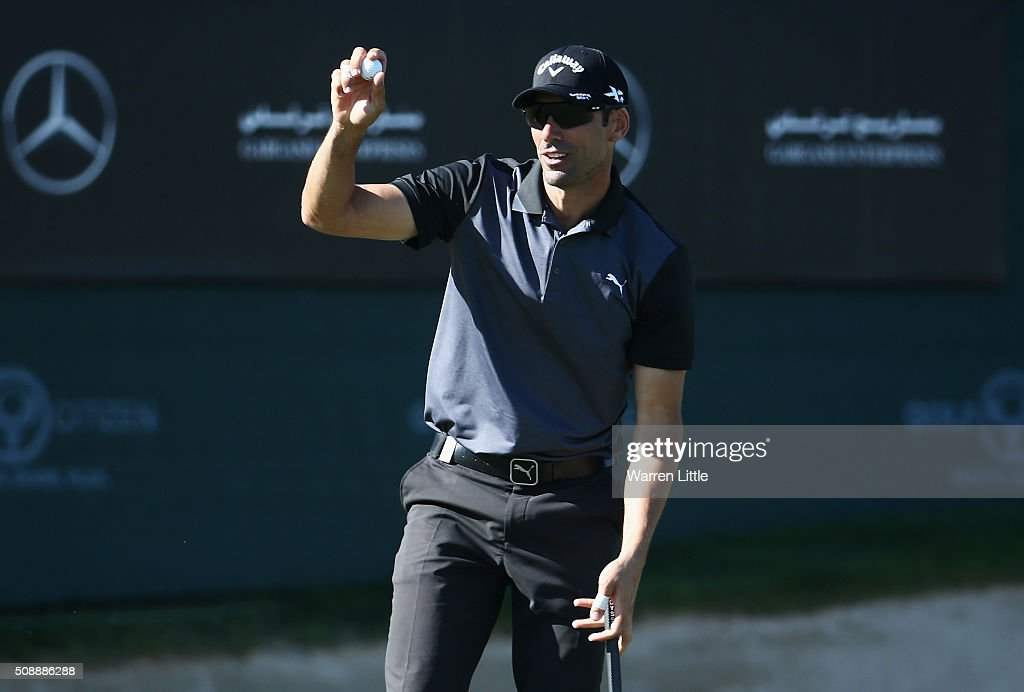 <a gi-track='captionPersonalityLinkClicked' href=/galleries/search?phrase=Alvaro+Quiros&family=editorial&specificpeople=776409 ng-click='$event.stopPropagation()'>Alvaro Quiros</a> of Spain acknowledges the crowd on the 18th green during the final round of the Omega Dubai Desert Classic at the Emirates Golf Club on February 7, 2016 in Dubai, United Arab Emirates.