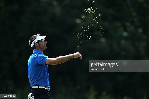 Alvaro Quiros of Spain checks the wind direction during the second round of the BMW International Open at the Munich North Eichenried Golf Club on...