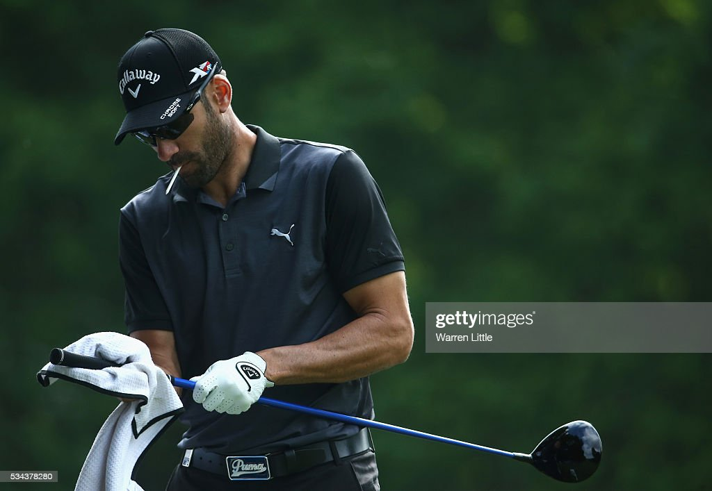 Alvaro Quiros of Spain dries his club on the 3rd hole during day one of the BMW PGA Championship at Wentworth on May 26, 2016 in Virginia Water, England.