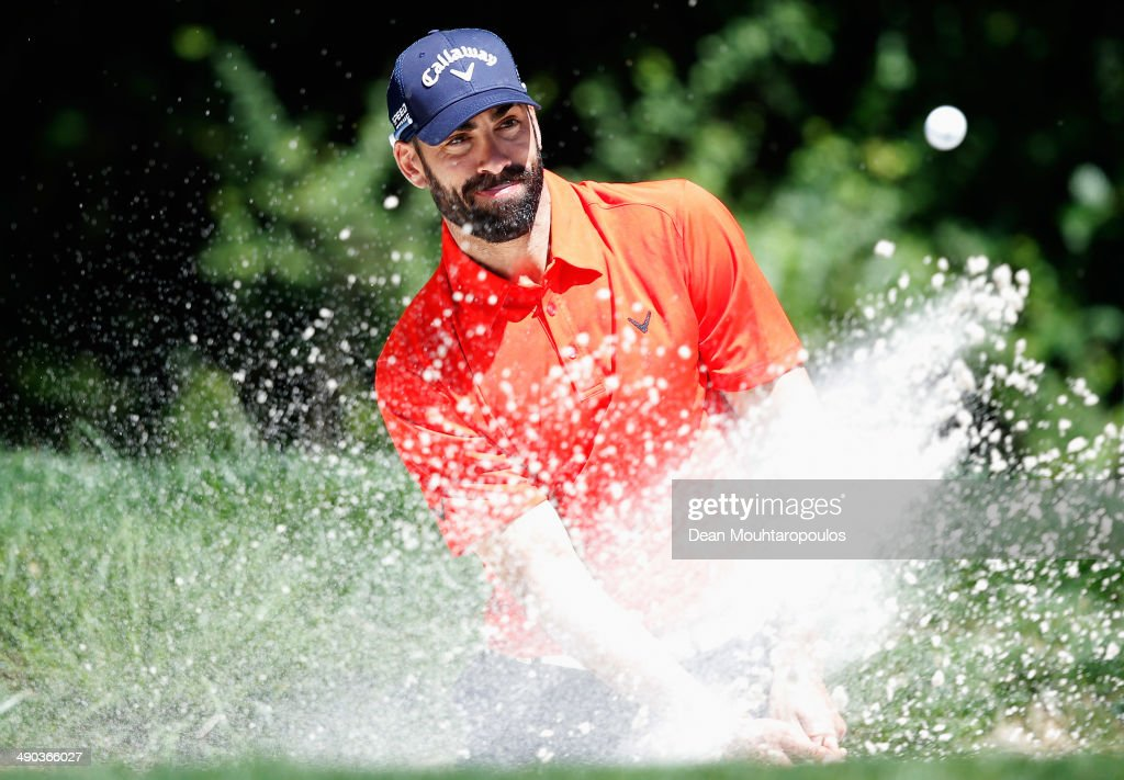 <a gi-track='captionPersonalityLinkClicked' href=/galleries/search?phrase=Alvaro+Quiros&family=editorial&specificpeople=776409 ng-click='$event.stopPropagation()'>Alvaro Quiros</a> of Spain hits a tee shot out of the bunker during the Open de Espana ProAm at PGA Catalunya Resort on May 14, 2014 in Girona, Spain.