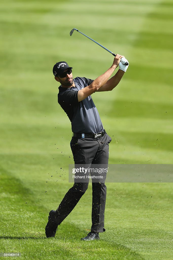 Alvaro Quiros of Spain hits his 2nd shot on the 4th hole during day one of the BMW PGA Championship at Wentworth on May 26, 2016 in Virginia Water, England.