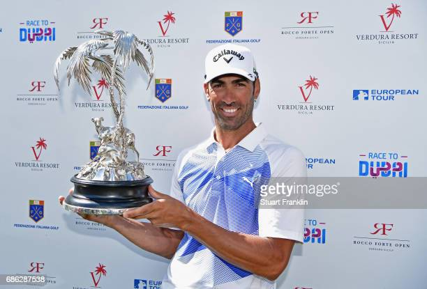 Alvaro Quiros of Spain lifts the trophy after winning the tournament during the final round on day four of The Rocco Forte Open at Verdura Golf and...