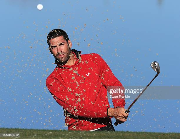 Alvaro Quiros of Spain plays a bunker shot during practice prior to the start of the World Golf ChampionshipsAccenture Match Play Championship held...