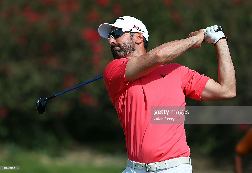 <a gi-track='captionPersonalityLinkClicked' href=/galleries/search?phrase=Alvaro+Quiros&family=editorial&specificpeople=776409 ng-click='$event.stopPropagation()'>Alvaro Quiros</a> of Spain plays a shot during day two of the Avantha Masters at Jaypee Greens Golf Club on March 15, 2013 in Delhi, India.