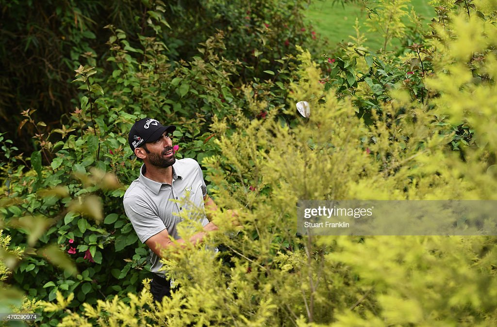Alvaro Quiros of Spain plays a shot from the bushes on the 18th hole during the final round of the Shenzhen International at Genzon Golf Club on April 19, 2015 in Shenzhen, China.