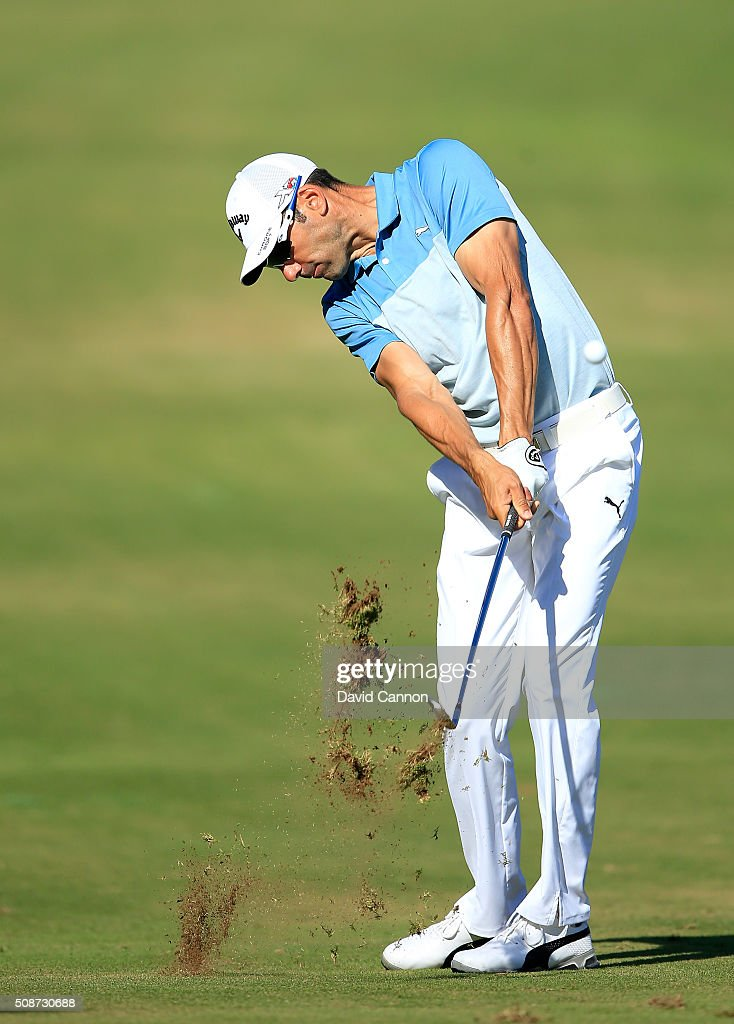 Alvaro Quiros of Spain plays his second shot at the par 4, 14th hole during the third round of the 2016 Omega Dubai Desert Classic on the Majlis Course at the Emirates Golf Club on February 6, 2016 in Dubai, United Arab Emirates.