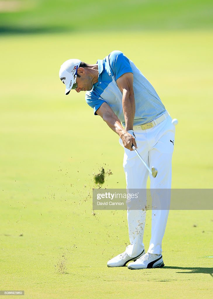 <a gi-track='captionPersonalityLinkClicked' href=/galleries/search?phrase=Alvaro+Quiros&family=editorial&specificpeople=776409 ng-click='$event.stopPropagation()'>Alvaro Quiros</a> of Spain plays his second shot at the par 4, first hole during the third round of the 2016 Omega Dubai Desert Classic on the Majlis Course at the Emirates Golf Club on February 6, 2016 in Dubai, United Arab Emirates.