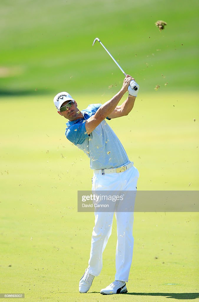 Alvaro Quiros of Spain plays his second shot at the par 4, first hole during the third round of the 2016 Omega Dubai Desert Classic on the Majlis Course at the Emirates Golf Club on February 6, 2016 in Dubai, United Arab Emirates.