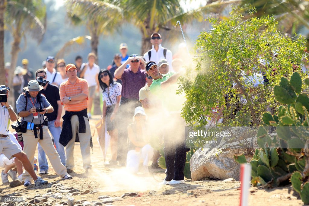<a gi-track='captionPersonalityLinkClicked' href=/galleries/search?phrase=Alvaro+Quiros&family=editorial&specificpeople=776409 ng-click='$event.stopPropagation()'>Alvaro Quiros</a> of Spain plays his third shot at the par 4, 9th hole during the final round of The Abu Dhabi Golf Championship at Abu Dhabi Golf Club on January 24, 2010 in Abu Dhabi, United Arab Emirates.