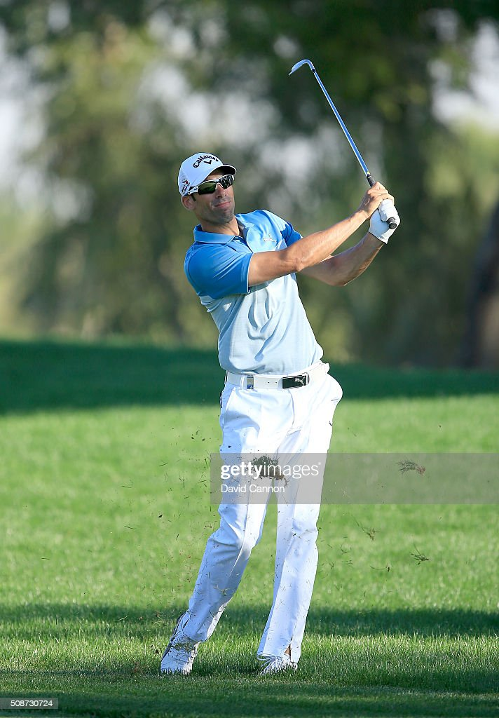 Alvaro Quiros of Spain plays his third shot at the par 5, 15th hole during the third round of the 2016 Omega Dubai Desert Classic on the Majlis Course at the Emirates Golf Club on February 6, 2016 in Dubai, United Arab Emirates.