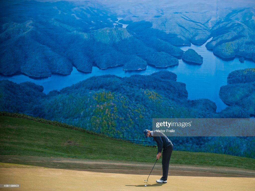 <a gi-track='captionPersonalityLinkClicked' href=/galleries/search?phrase=Alvaro+Quiros&family=editorial&specificpeople=776409 ng-click='$event.stopPropagation()'>Alvaro Quiros</a> of Spain putts on at the 6th green during the Royal Trophy Europe vs Asia Championship at the Dragon Lake Golf Club on December 20, 2013 in Guangzhou, China.
