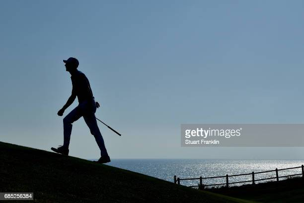 Alvaro Quiros of Spain walks down the 18th hole during the second round of The Rocco Forte Open at The Verdura Golf and Spa Resort on May 19 2017 in...