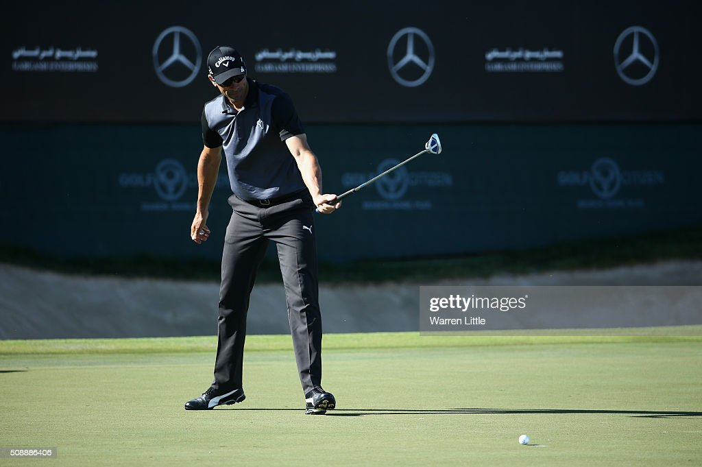 <a gi-track='captionPersonalityLinkClicked' href=/galleries/search?phrase=Alvaro+Quiros&family=editorial&specificpeople=776409 ng-click='$event.stopPropagation()'>Alvaro Quiros</a> of Spain watches his putt on the 18th green during the final round of the Omega Dubai Desert Classic at the Emirates Golf Club on February 7, 2016 in Dubai, United Arab Emirates.